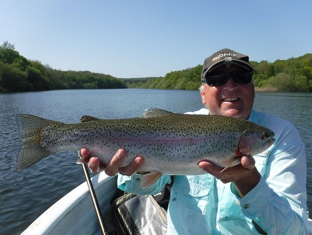 James Gardner with a fine mayfly munching Rainbow