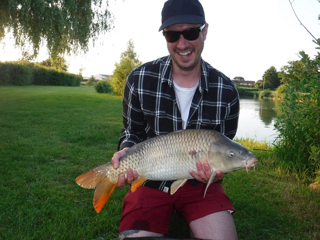 "Jacob Harman looking very pleased with his first ""Carp on the fly"""